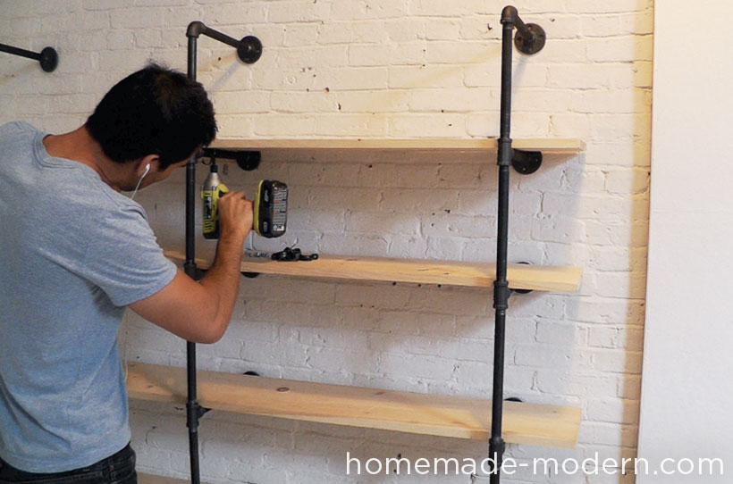 Use the pipe hangers to secure the boards to the pipes.