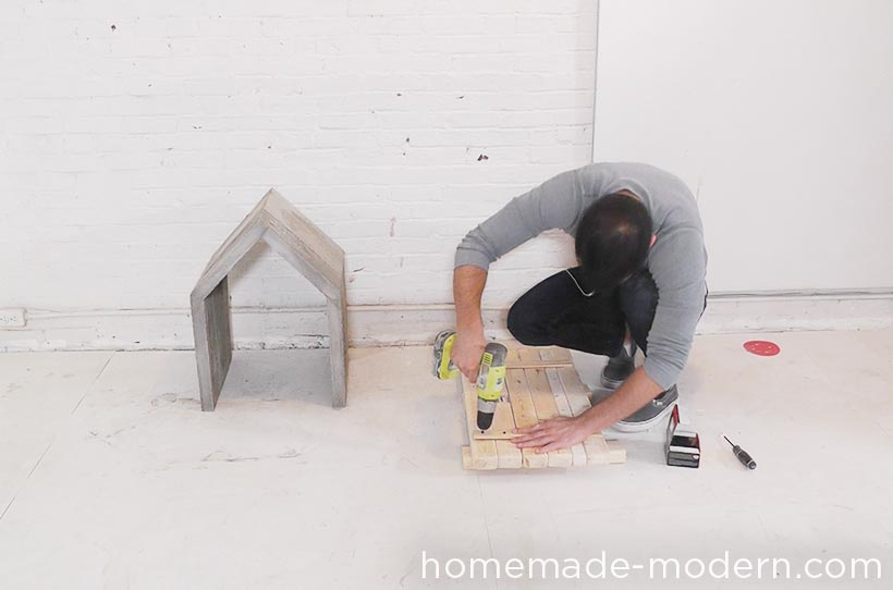 This modern concrete doghouse is made out of Quikrete Countertop Mix poured into a mold made out of 2x4s and Masonite. I poured the concrete in layers so that the weight of the wet concrete would not push the thin Masonite out. For full instructions go to HomeMade-Modern.com.