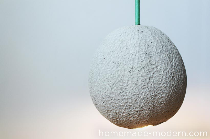 I've always like the texture of cantaloupes, so I made this concrete lamp by creating a silicone mold with a real cantaloupe and then casting a hollow concrete version. I used a plastic water bottle and a threaded rod to make the chase and hollow part of the lamp and a cloth cord from ColorCord.com to wire the lamp. For more information go to HomeMade-Modern.com.