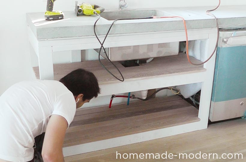 This entire DIY kitchen project cost less than $3500 for everything including appliances. There are three videos on the HomeMade Modern YouTube channel that show how to make the kitchen cabinets, concrete countertops and open shelving. For more information go to HomeMade-Modern.com.