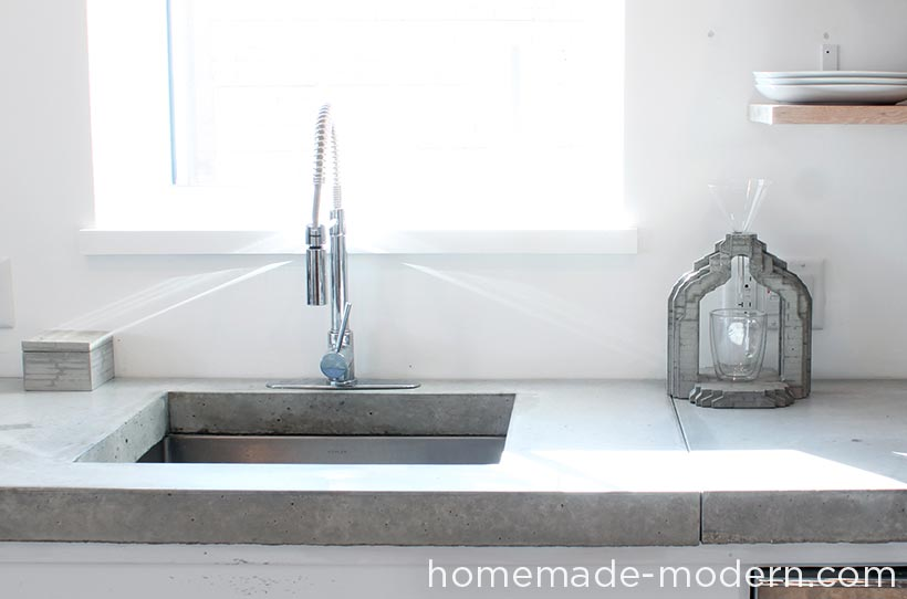 This concrete kitchen countertop was built for less than $120. The entire kitchen is a DIY project that costs less than $3500 for everything including appliances. There are three videos on the HomeMade Modern YouTube channel that show how to make the kitchen cabinets, concrete countertop and open shelving. For more information go to HomeMade-Modern.com.