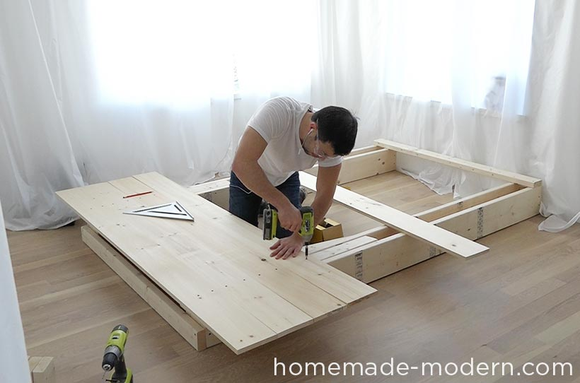 This DIY platform bed is made out of 2x8s, 2x4s and pine boards. I made this one for a full-sized mattress, but the design can be scaled up or down for different sized mattresses. This modern bed also has storage underneath it. For more information go to HomeMade-Modern.com.